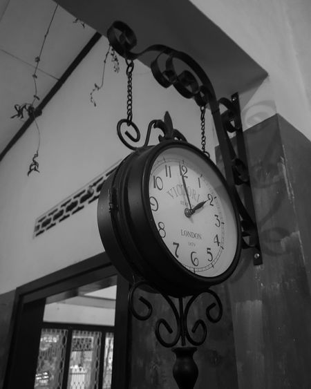 Low angle view of clock on wall