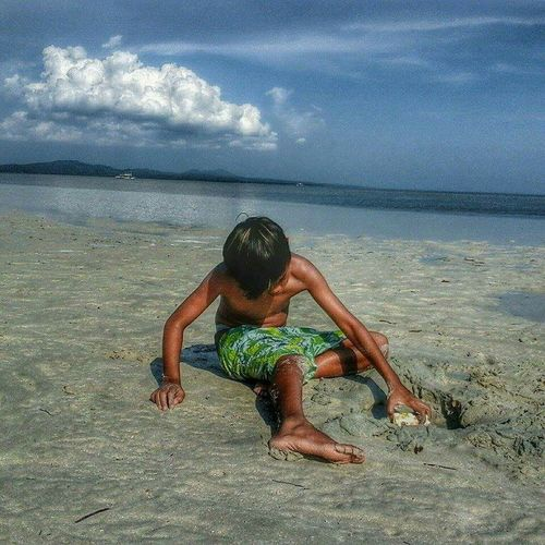 The Portraitist - 2015 EyeEm Awards Playing on the sand with a sunkissed skin. VisitingCagbalete Summer2015 Itsmorefuninthephilippines Goodlife ♥♥♥