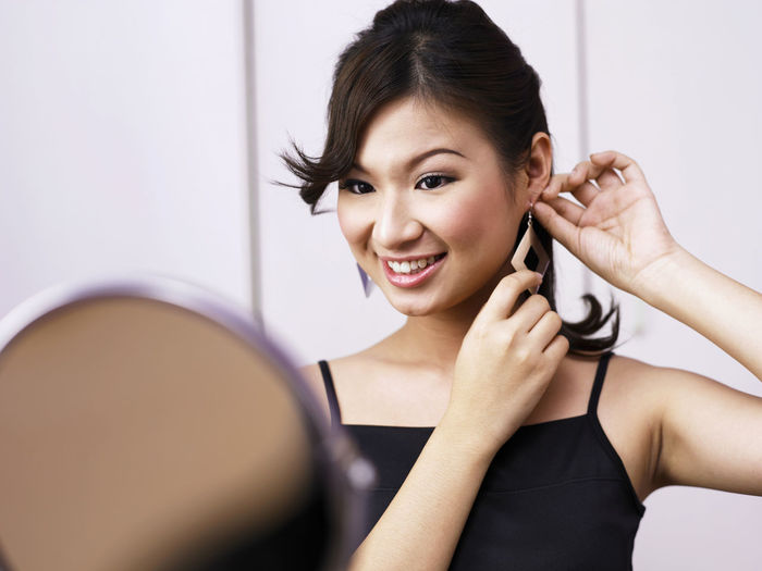 Close-Up Of Smiling Woman Wearing Earring