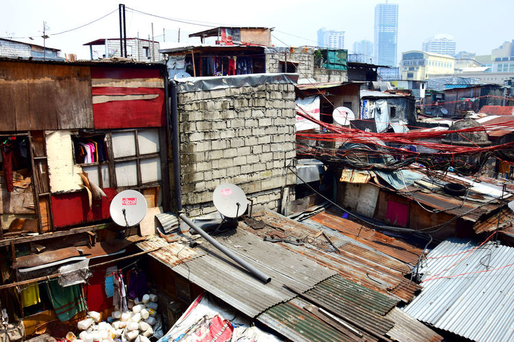 Shanties erected in the city Dwellings Electric Wires Housse Poor  Poverty Roof Shacks Shanties Tattered Houses