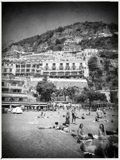 Beach. Architecture Auto Post Production Filter Black And White Black And White Photography Building Exterior Built Structure City Day Italy Large Group Of People Mountain Nature Outdoors People Popckorn Positano Real People Sky Travel Destinations Tree