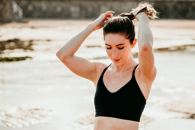 Beautiful woman standing at beach