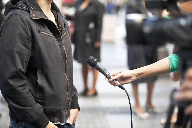 TV interview Journalist Press Answering Questions Asking Question Broadcasting Journalism Comment Correspondent Holding Human Hand Information Media Media Event Media Interview Microphone News News Conference Occupation Report Reportage Reporter Television Tv Video Camera