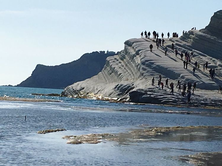 Scala Dei Turchi Agrigento Sicily Nature Beauty In Nature Water Scenics Day Outdoors No People Tranquil Scene Clear Sky Sea Tranquility Sky Large Group Of Animals Mountain Animal Themes The Great Outdoors - 2017 EyeEm Awards Your Ticket To Europe Summer Exploratorium