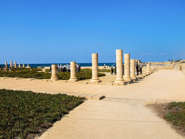 Caesarea's Antiquities Park Ancient, Antique, Archeology, Architecture, Art, Asia, Background, Beach, Beauty, Bible, Blue, Brick, Bright, Building, Caesarea, Calm, City, Clouds, Coast, Coastline, Construction, Culture, Harbor, History, Holy, Israel, Judea, Landmark, Landscape, Lines Beauty In Nature Blue Caesarea, Israel, Keysarya, Palestine, Arab, Jew, Israeli, Palestinian Caesarea's Antiquities Park Clear Sky Day Diminishing Perspective Empty Fishing Harbor Footpath Grass Horizon Over Water King Herod, Augustus Caesar, Caesar Long Narrow Nature Pathway Scenics Sunlight The Way Forward Tranquil Scene Tranquility Walkway Water