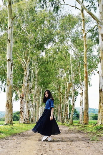 Model : @keeyawnahLet's Go. Together. Tree Full Length Day One Person Young Adult Outdoors Sitting Nature People Adult Beauty In Nature Adults Only Traveling Tree Area EyeEm Selects Sommergefühle EyeEmNewHere Breathing Space Thrift Store Finds Fashion Skirt Eyeem Philippines Perspectives On Nature