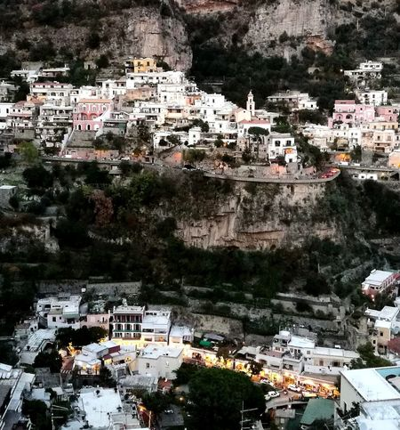Positano is like a fairy world, especially when the lights start coming on and you just see thousands of tiny sparkles High Angle View Building Exterior Architecture Built Structure Outdoors City Day Cityscape Town No People Mountain Community Connected By Travel Lost In The Landscape Nature Directly Above Positano Positano, Italy