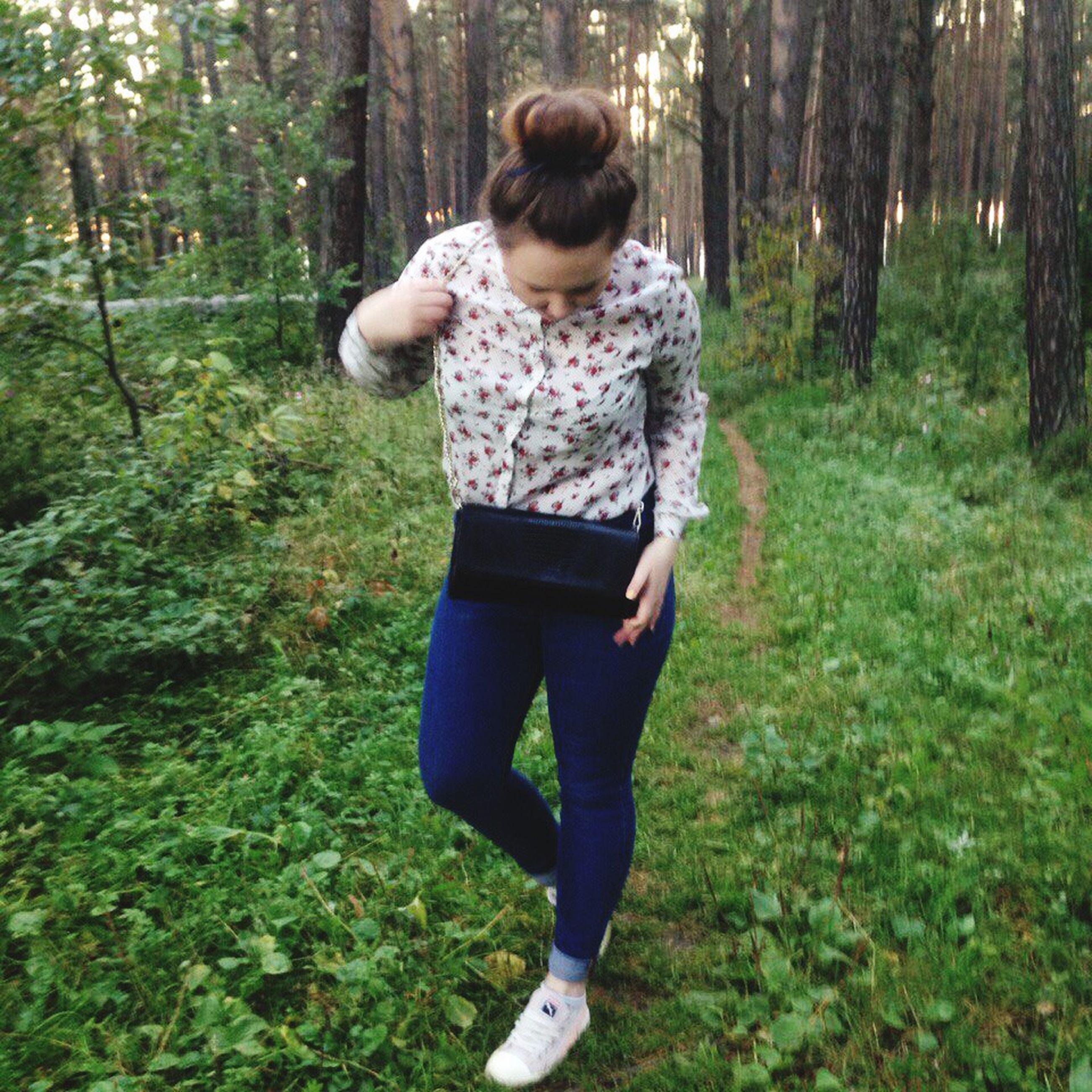 lifestyles, casual clothing, full length, tree, leisure activity, grass, person, standing, young adult, growth, childhood, field, rear view, front view, three quarter length, forest, green color, young women
