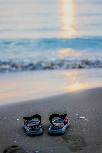 Slippers On Beach At Sunrise