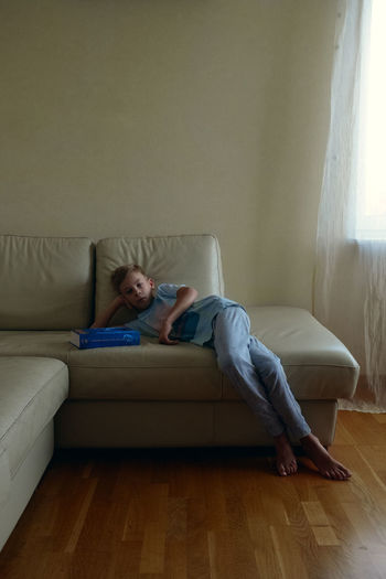 Child Childhood Teenager Laying Down Book Home Interior Indoors  Lifestyles The Week on EyeEm Sofa One Person Indoors  Relaxation Living Room Real People Contemplation Casual Clothing Lying Down Leisure Activity Front View Home Interior
