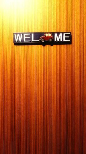Welcome sign hanging in the door Text Communication Wood - Material No People Close-up Day Indoors  Welcome Welcome Sign Welcome Signs Sign Door Door Sign Doorsign Welcomehome Welcome Home Home Sweet Home ♥ Home Interior Art Art Is Everywhere Art And Craft Art Photography