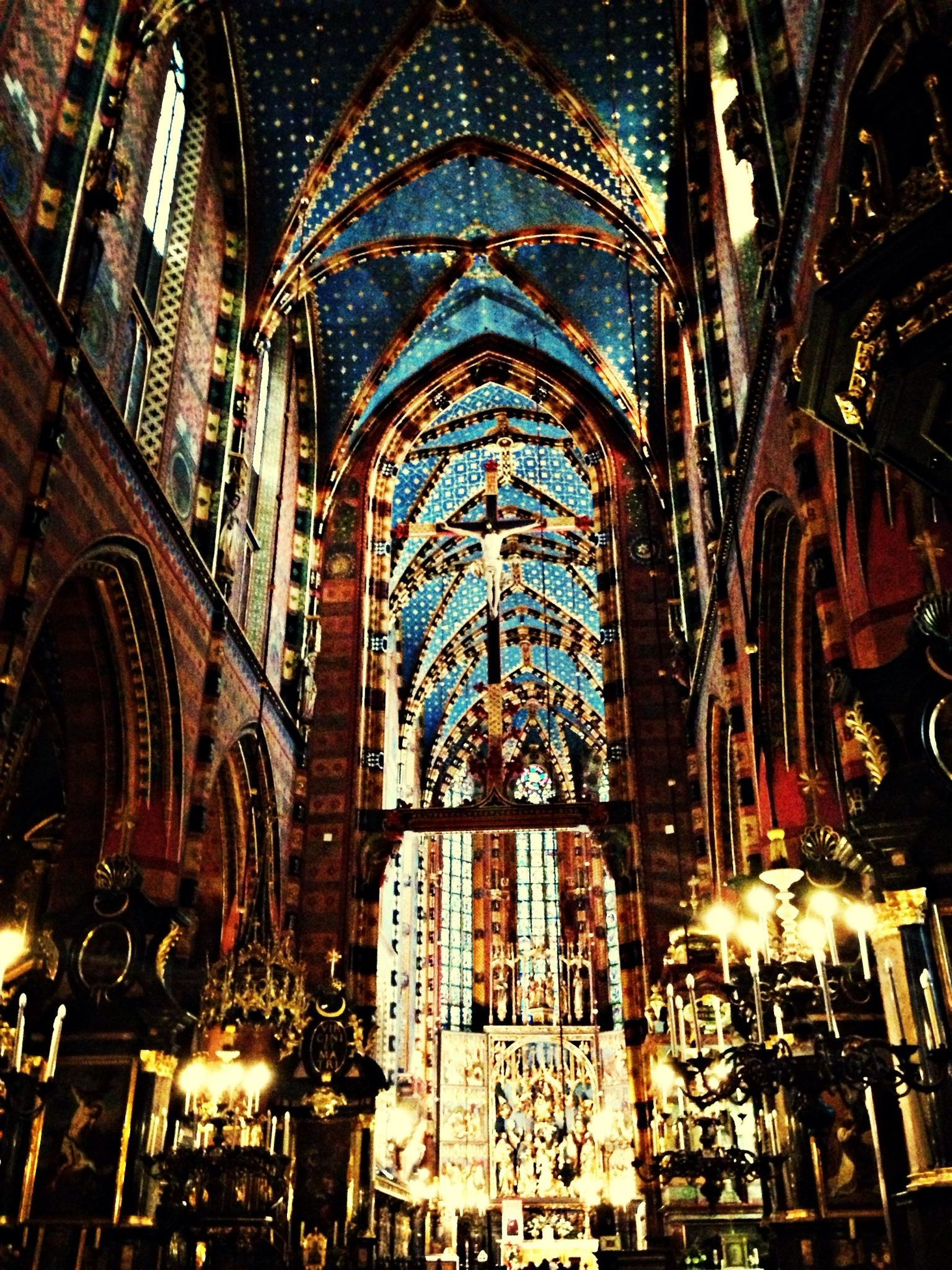 architecture, religion, place of worship, spirituality, built structure, church, building exterior, cathedral, arch, indoors, low angle view, illuminated, window, history, ornate, night, travel destinations, no people