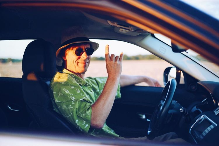 Driving Traveling Travel Mode Of Transportation Car Motor Vehicle Transportation One Person Vehicle Interior Driving Car Interior Men Sunglasses Glasses Portrait Steering Wheel Road Trip Outdoors Moments Of Happiness