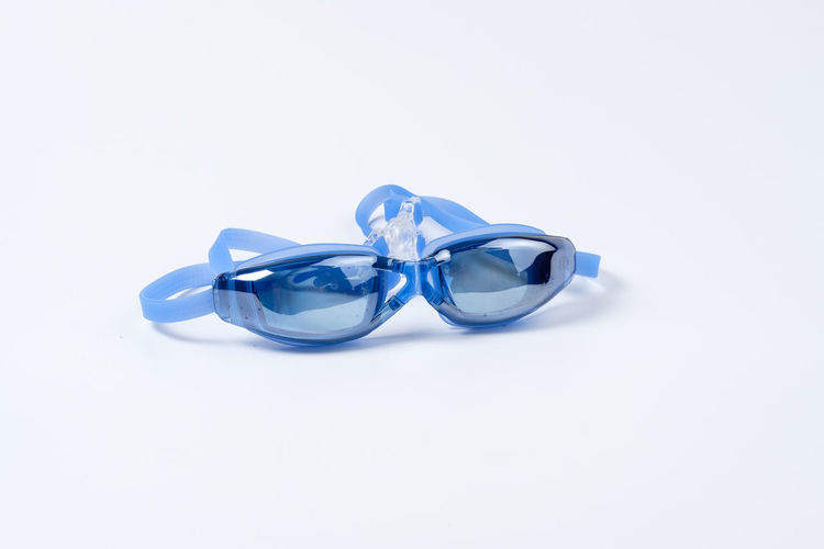 Blue Clean Equipment Glossy Goggle Goggles Rubber Swim Swimming Swimming Goggle White White Background Studio Shot Copy Space Still Life Indoors  Close-up No People Celebration Love Ring Cut Out Two Objects Emotion Event Jewelry Positive Emotion Ribbon Life Events Wedding Luxury Personal Accessory