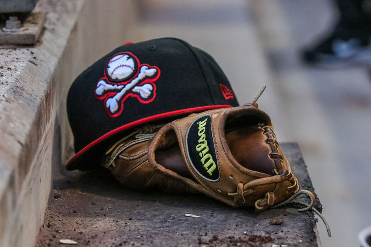 Waiting... El Paso Chihuahuas Baseball Cap Baseball Glove Close-up Day Focus On Foreground Headwear Helmet Leather No People Outdoors Pair Protection Security Selective Focus Shoe Shoelace Sport Sports Equipment Sports Helmet Still Life Toy Car