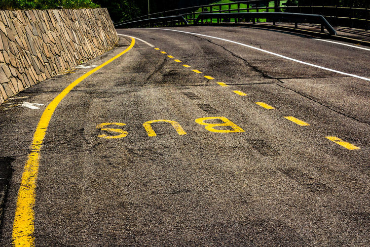 Sign Road Transportation Yellow Day Text The Way Forward No People Direction Road Marking Symbol Communication Asphalt Marking High Angle View Outdoors Street Western Script City Guidance Dividing Line