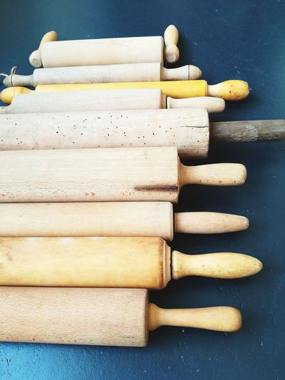 High angle view of wooden rolling pins on table