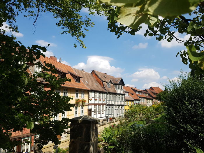 Quedlinburg House Tree Cloud - Sky Building Exterior Outdoors Architecture Residential Building Day Sky Built Structure Roof No People Naturally Framed Cityscape Beautiful Cityscape Fachwerkhäuser Houses And Homes Harz Travel Destinations Scenics Tourist Attraction  Popular Sights Blue Sky And White Clouds The Week On EyeEm