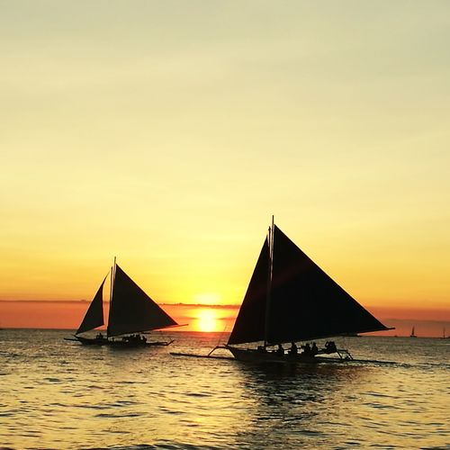 Sunset in Boracay, Philippines Sunset Sailboat Reflection Silhouette Travel Sea Travel Destinations Architecture Nautical Vessel Outdoors Sky Water People Nature