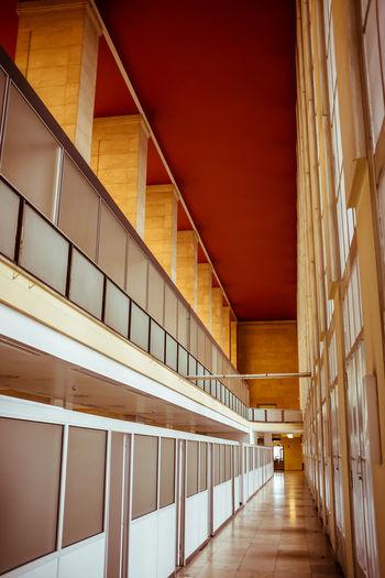 Empty long corridor along walls