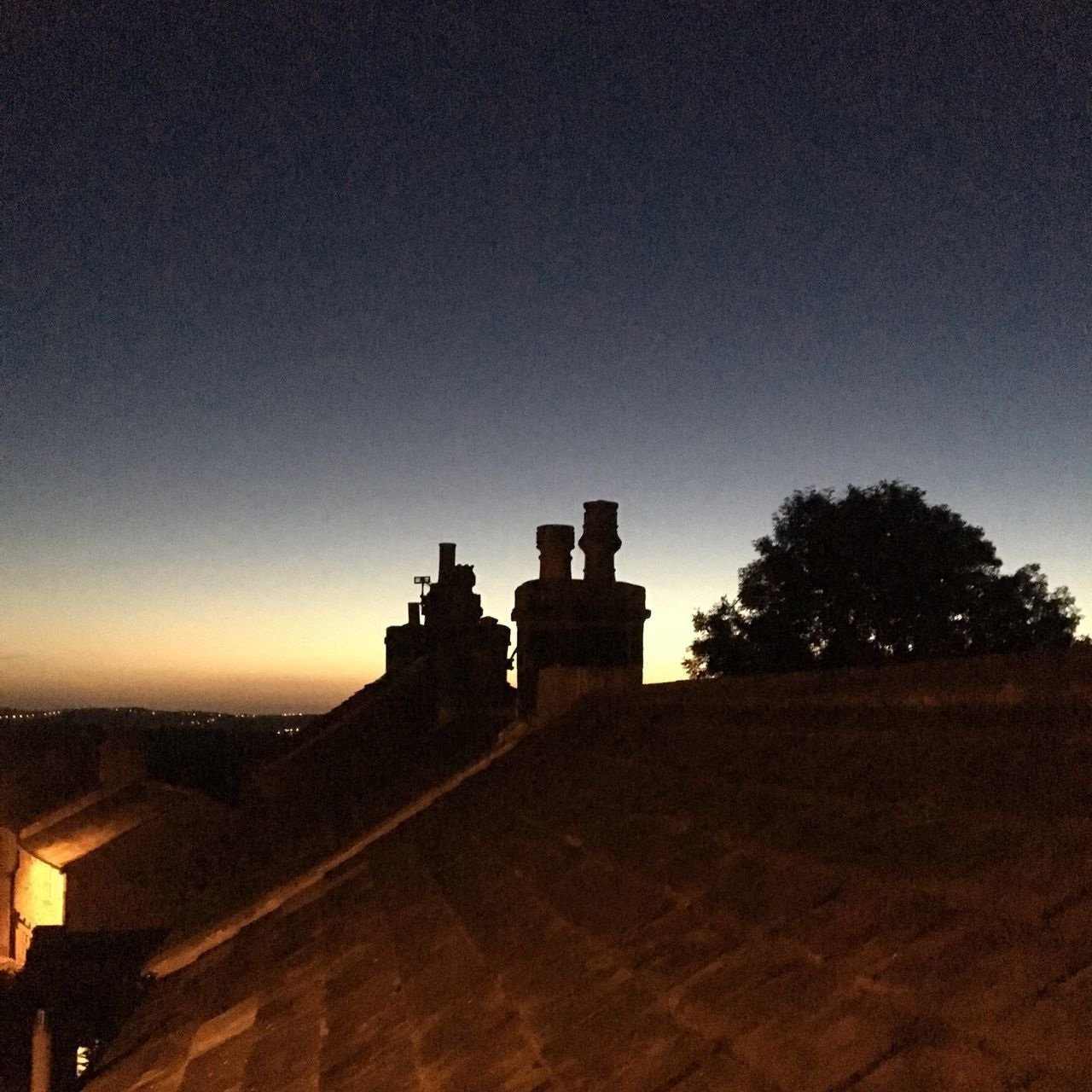 sky, architecture, built structure, building exterior, nature, no people, building, copy space, silhouette, tree, history, sunset, the past, plant, outdoors, clear sky, fort, dusk, landscape, scenics - nature