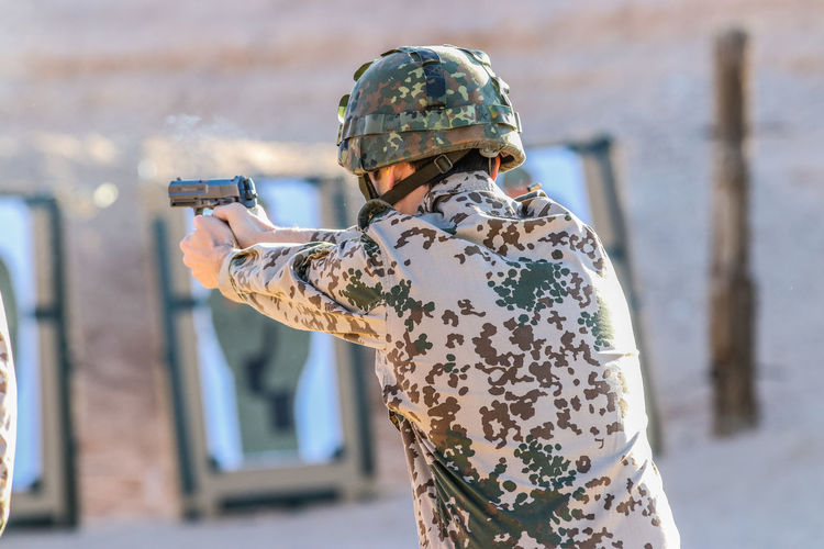 Qualifying for the German Proficiency Badge. Adult Aiming Armed Forces Army Army Soldier Camouflage Clothing Day Focus On Foreground Government Gun Holding Machine Gun Military Military Uniform Nature One Person Real People Rifle Uniform Weapon