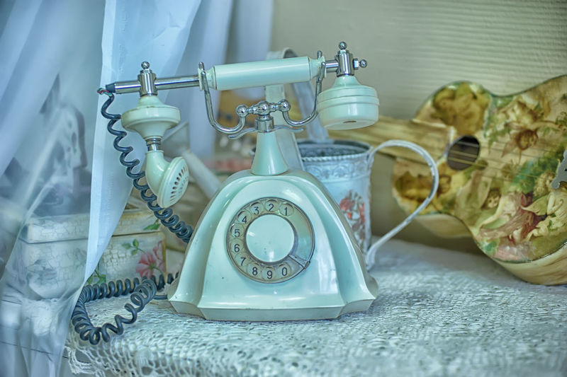 Close-up of vintage telephone on table