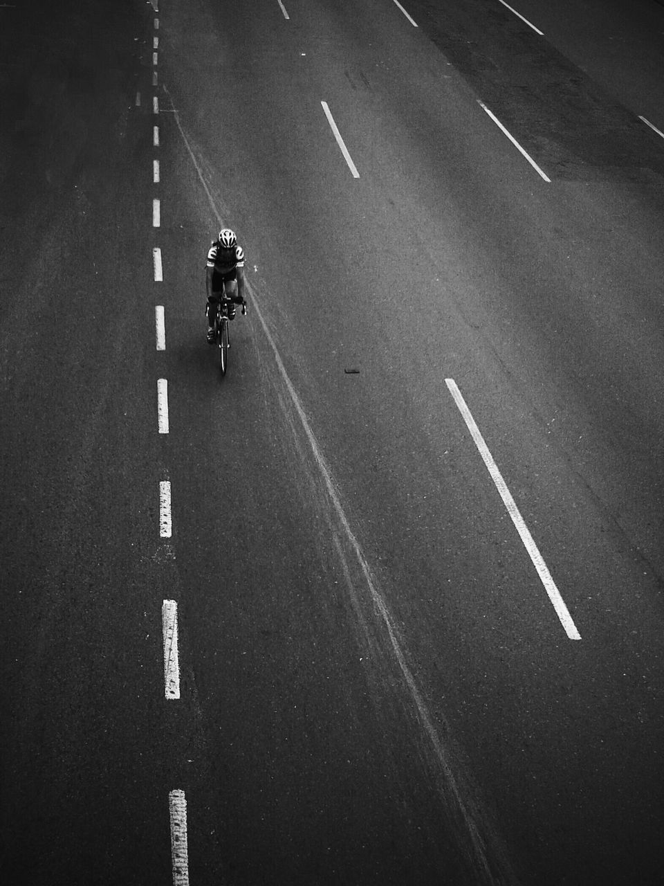 High angle view of person cycling on road