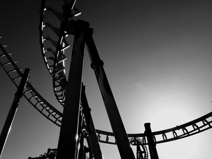 Low Angle View Of Rollercoaster In Amusement Park Against Sky