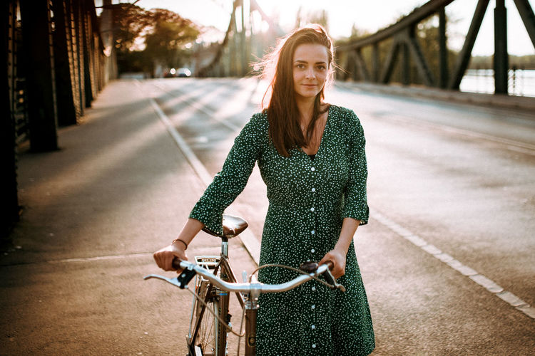 Portrait of young woman riding bicycle
