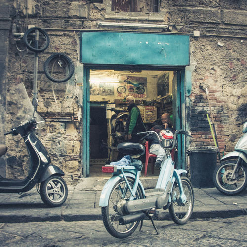 Italy❤️ Italian City Streetphotography Street Transportation Architecture Mode Of Transportation One Person Bicycle Full Length Building Exterior City Day Men Built Structure Casual Clothing Adult Young Adult Young Men Land Vehicle Travel Portrait City Life Outdoors Scooters Mechanic Motor Scooter Sitting Motorcycles Garage Repairshop The Art Of Street Photography