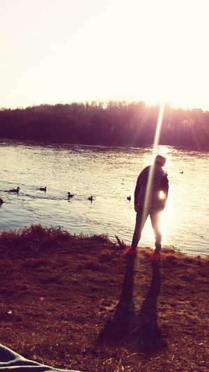 my friend catch this moment while I was feeding ducks :)) moreover, today we walked about 8 kilometres because of Geocaching at Kaunas. I could say .. Wonderful day, wonderful weather with wonderful friends :)) Walking Geocaching Places Kauno Marios Sunset