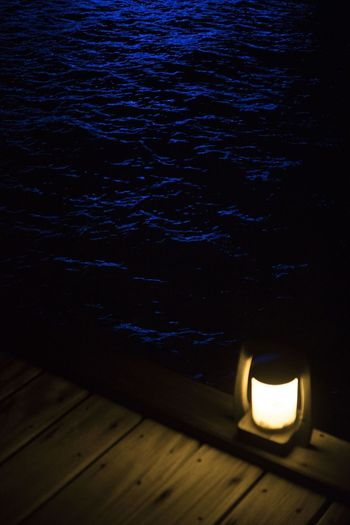 Close-up Illuminated Indoors  Komandoo Lantern Lighting Equipment Maldives Nature Night No People Pier Water Wood - Material