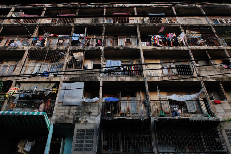 Low Angle View Of Clothes Drying On Balconies