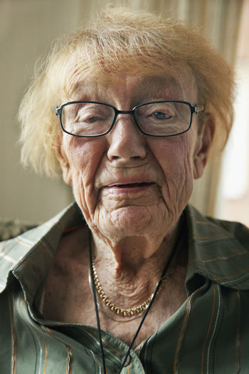 Portrait of mid adult woman wearing eyeglasses