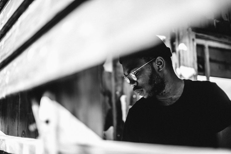 Elton Selective Focus Side View Focus On Foreground Contemplation Casual Clothing One Mid Adult Man Only Day Traveling Human Face Portrait Black & White Black Male The Portraitist - 2017 EyeEm Awards 17.62°
