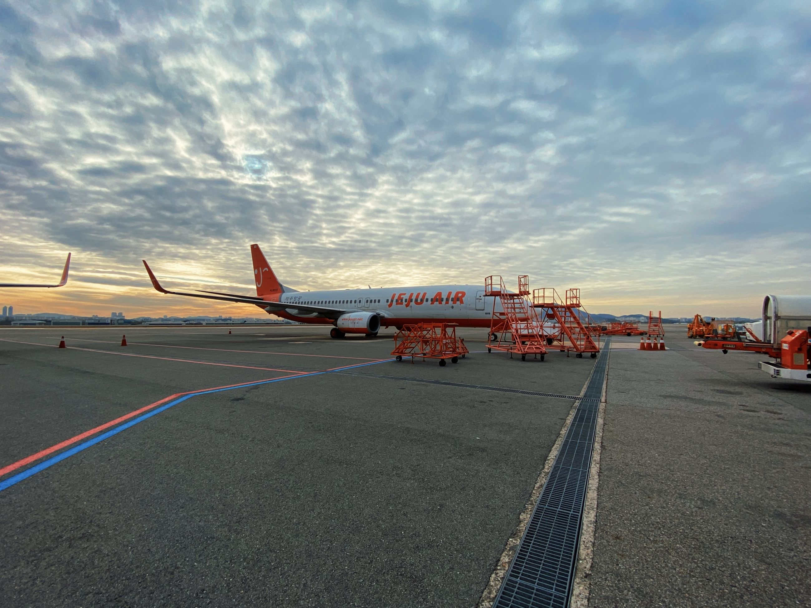 transportation, mode of transportation, sky, tarmac, airplane, airport, air vehicle, cloud, infrastructure, airport runway, travel, road, vehicle, nature, asphalt, aviation, no people, sunset, aircraft, outdoors, architecture, business, airliner