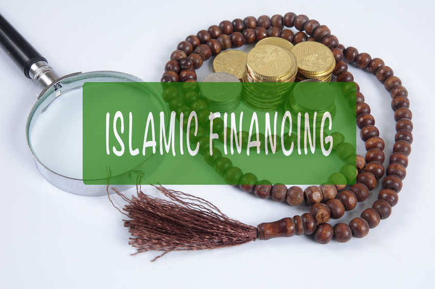 ISLAMIC FINANCING CONCEPTUAL TEXT WITH COINS,ROSARY AND CALCULATOR Rosary Bank Banking, Business, Chart, Coins, Concept, Conceptual, Consultant, Corporate, Dividends, Finance, Financial, Government, Graph, Green, Growth, Help, Income, Investment, Islamic, Management, Personal, Plan, Profit, Retirement, Smart, Solution, Structure, Sy Brown Calculator Capital Letter Close-up Coins On The Table Communication Conceptual Container Food Food And Drink Freshness Green Color High Angle View Indoors  Islamic Banking Islamic Financing No People Sign Single Word Still Life Studio Shot Text Wellbeing Western Script White Background