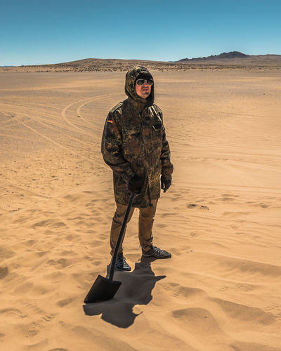 Mongolia Desert Sand Land Arid Climate Climate One Person Real People Landscape Full Length Front View Clothing Nature Lifestyles Environment Standing Scenics - Nature Sand Dune Sky Mid Adult Uniform Government The Traveler - 2019 EyeEm Awards
