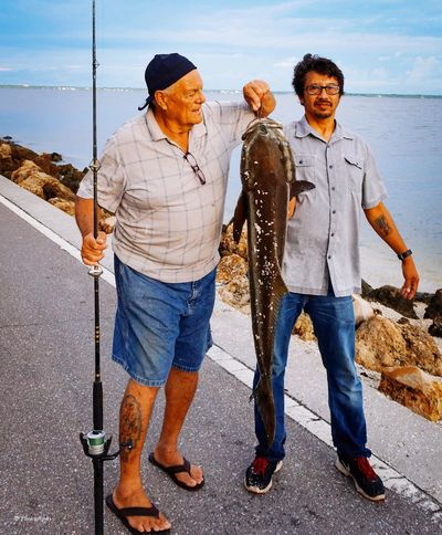 All In a Days Fishin Full Length Men Togetherness Real People Casual Clothing Group Of People This Is Aging Lifestyles Outdoors Leisure Activity Nature Water Friendship Males