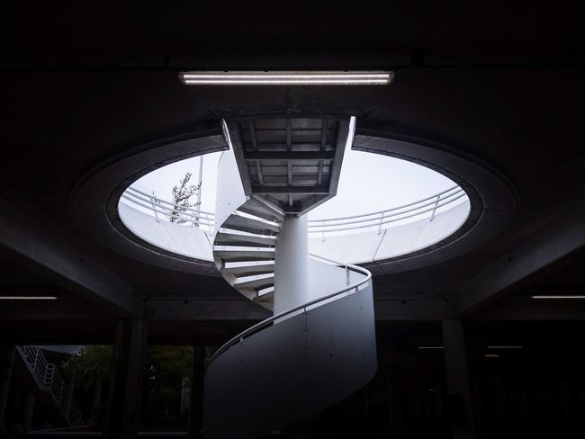 IPhoneography Iphoneonly IPhone Mobilephotography Symmetry Daylight Light And Shadow Contrast Parking Staircase Stairs Architecture Built Structure Indoors  Low Angle View Ceiling No People