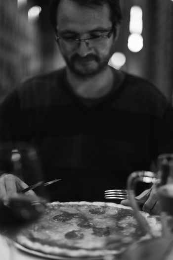 Man eating pizza One Person One Man Only Real People Close-up Black And White Friday Black And White Black And White Photography Bw_lover BW_photography Bw_collection Pizza Pizza Time Bokehlicious Soft Focus Black And White Friday