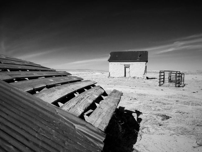 """""""Mystery Ranch No. 25"""" The collapse. New Mexico Photography New Mexico Skies New Mexico Collapse Roofs Abandoned & Derelict Abandoned Buildings Abandoned Places Abandoned Blackandwhite Photography Black & White Black And White Blackandwhite Wood - Material Built Structure Abandoned No People Day Outdoors Architecture"""