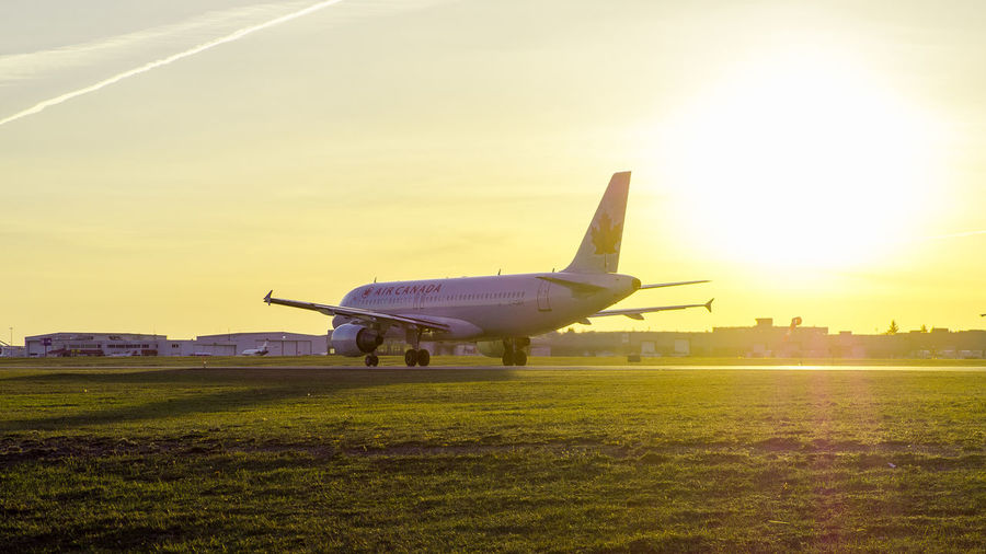 An Air Canada flight ready to take-off in the sunset. Afternoon Afternoon Sun Air Vehicle Aircanada Airplane Airport Airport Runway Aviation Aviationlovers Aviationphotography Canada Commercial Airplane Flying Grass Ottawa Photo Photoshoot Runway Sky StrikeEagle Sunset TakeOff Transportation Travel