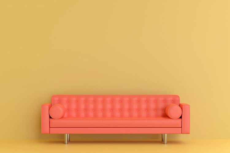 Indoors  Red Seat Yellow No People Copy Space Chair Studio Shot Colored Background Furniture Single Object Domestic Room Armchair Man Made Object Wall - Building Feature Man Made Pink Color Empty Still Life Wood - Material Luxury Cozy