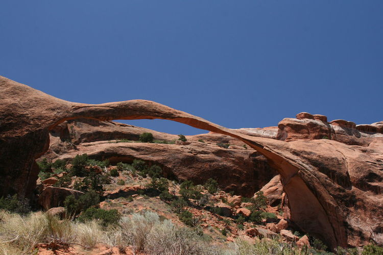 Low angle view of natural arch against clear sky at arches national park