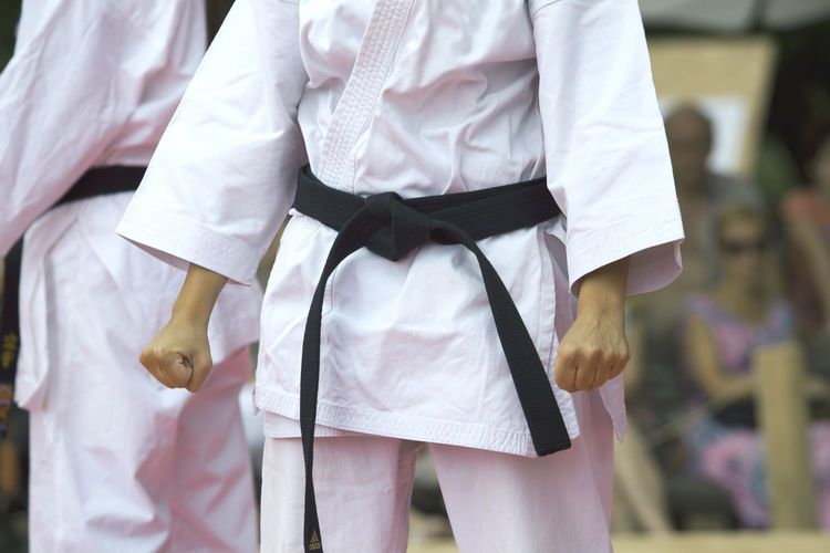 Midsection of women standing during karate