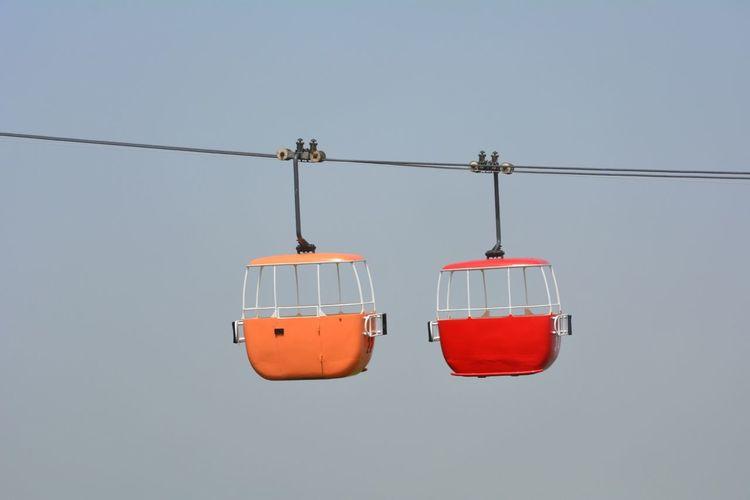 Overhead Cable Cars Against Clear Sky