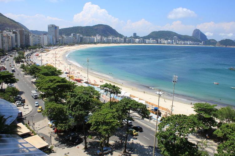 Copacabana Beach Rio De Janeiro Blue Wave Blue Sky Beauty In Nature Ocean Famous Beach Sugar Loaf Mountain