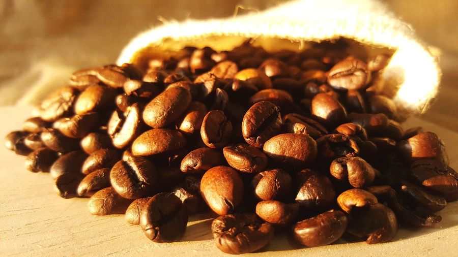 Close-up of roasted coffee beans on table